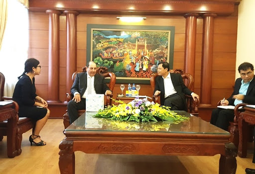Yhaska Ginsberg with the leaders of the Ministry of Agriculture and Rural Development in Vietnam